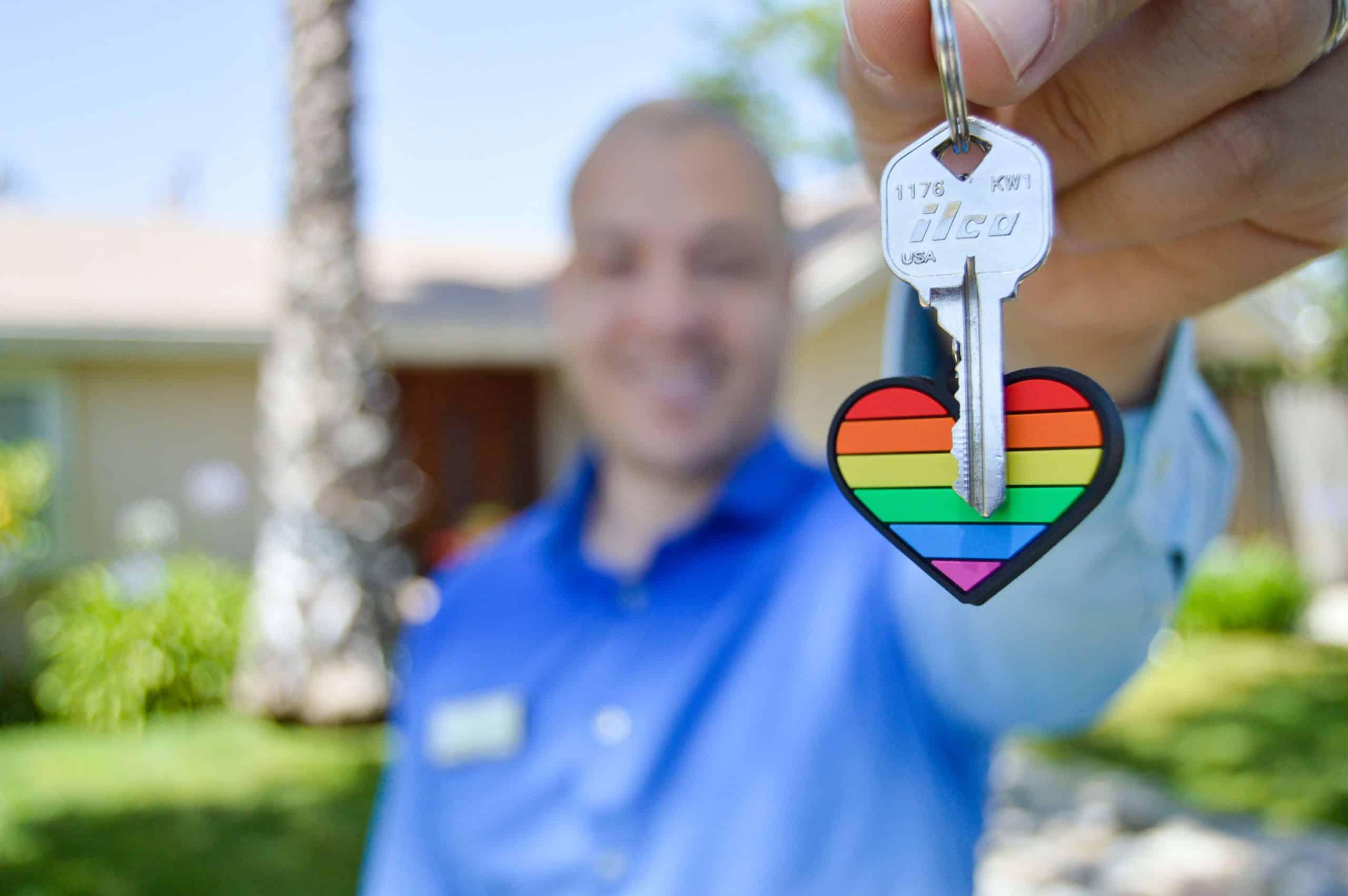 Selective photo of gray key with heart key chain